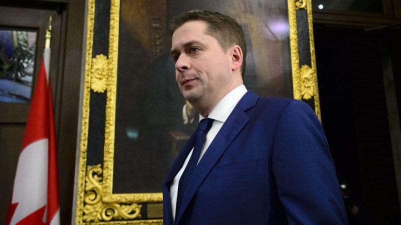 Премьер-министр Канады желает судить лидера оппозиции за клевету